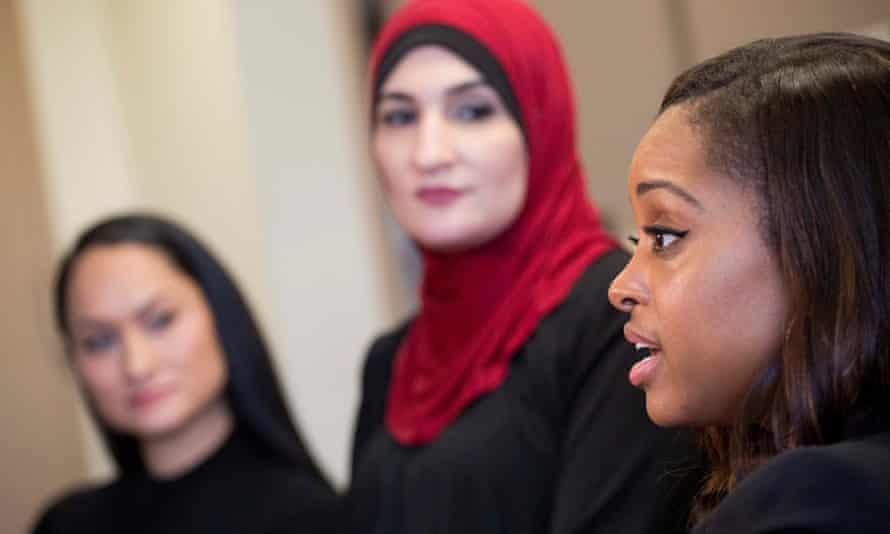 Tamika Mallory, right, co-chair of the Women's March on Washington, talks alongside fellow co-chairs Carmen Perez, left, and Linda Sarsour, in New York.