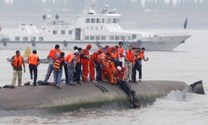 A man is pulled out alive from the capsized ship by divers and rescuers on Tuesday.