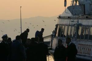 People board a ferry to Turkey