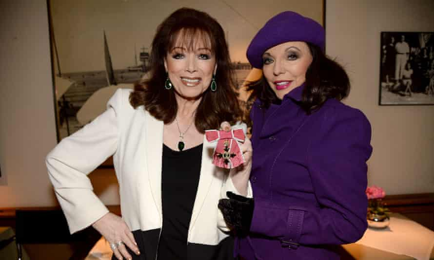 Jackie Collins, left, with sister Joan in 2013 after being awarded an OBE.