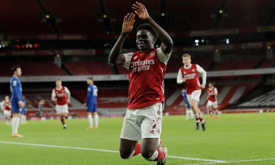 Bukayo Saka celebrates after his long-range goal made it 3-0 to Arsenal.