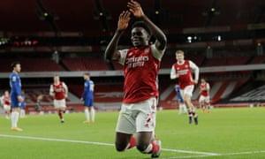 Bukayo Saka celebrates after scoring Arsenal's third.