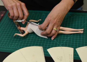 A person making a doll