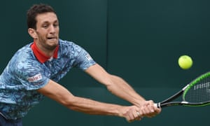 James Ward stretches to return during his straights sets defeat.
