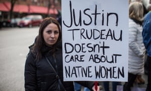 A First Nations woman holds a sign at a 2018 march in Vancouver.