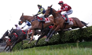 Tiger Roll, right, returns to Cheltenham as a Grand National winner after winning the Festival's Cross Country race in 2017.
