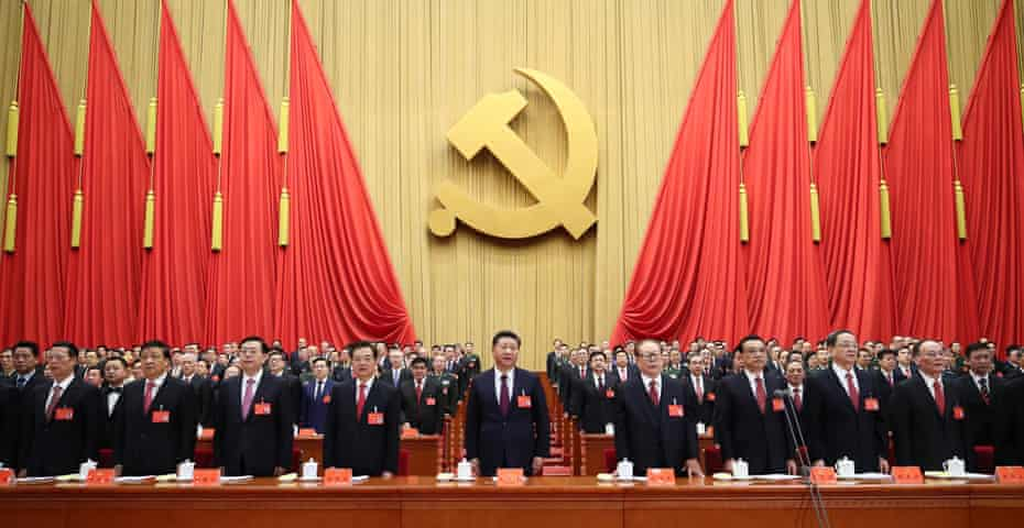 Xi Jinping (centre) prepares to deliver a marathon three and a half hour speech at the CPC congress.