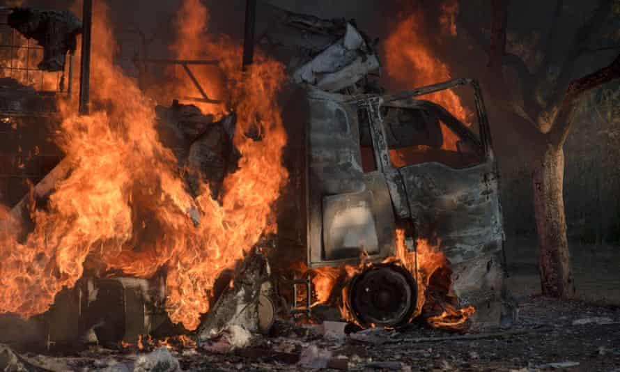 A truck set alight during the violent protests in Pretoria.