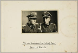 In 1945, an American officer found an album of photos in a bombed-out Frankfurt apartment. They appeared to be of ordinary men and women, except that nearly all of them were wearing SS uniforms. The owner of the album was the man on the right: Karl-Friedrich Höcker. He was adjutant to the man on the left, Richard Baer, the commandant of Auschwitz from May 1944 until the Russians arrived in 1945. This photo was taken a few weeks after Baer and Höcker arrived at Auschwitz. A glass has left a mark on the page – as if the American officer sometimes took the photos out to show friends