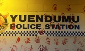 Handprints left from a vigil outside Yuendumu police station