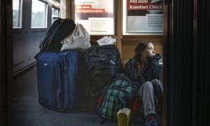 An image taken from Greta Thunberg's Twitter account, which shows her sitting on the train's floor.