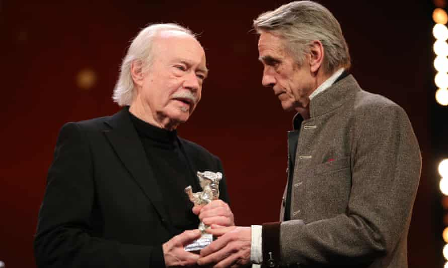 Actor Jeremy Irons (right) presents Jürgen Jürges with an award for DAU. Natasha at the Berlin film festival