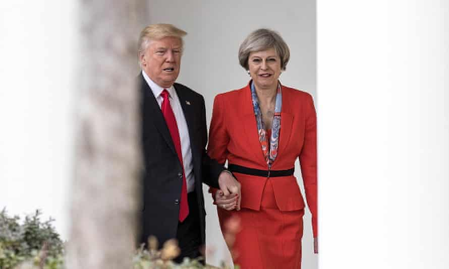 Trump and May hand in hand