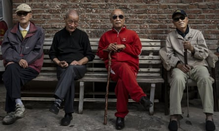 Row of old Chinese men on a bench