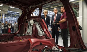 Theresa May, with Philip Hammond, visiting the Jaguar Land Rover factory