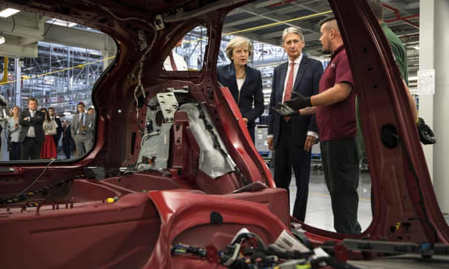 Hammond and Theresa May visiting the Jaguar Land Rover factory in Solihull last year.