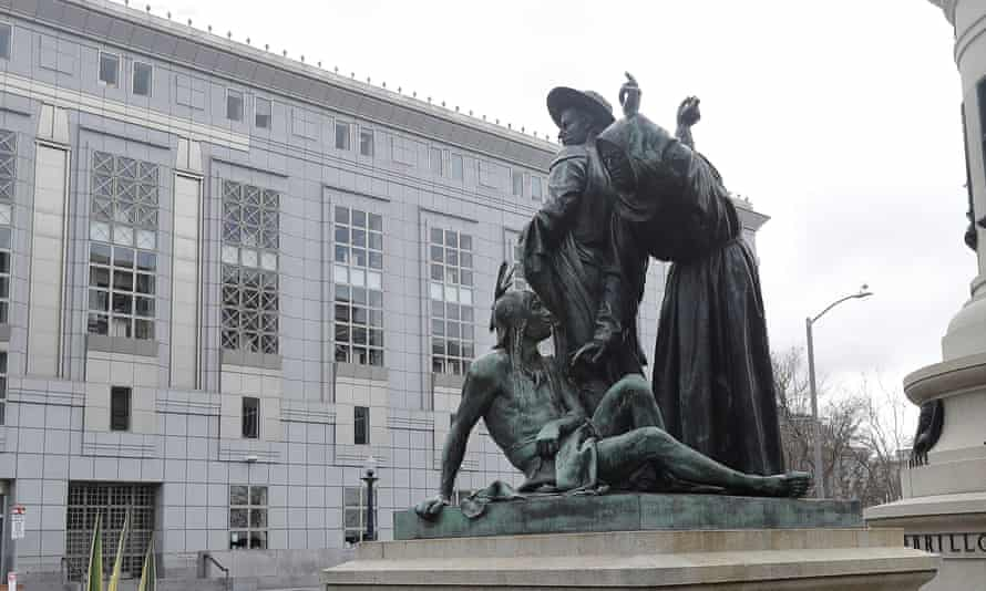 A statue depicts a Native American at the feet of a Spanish cowboy and Catholic missionary in San Francisco. Missionaries brought measles and other diseases, which killed many Ohlone.
