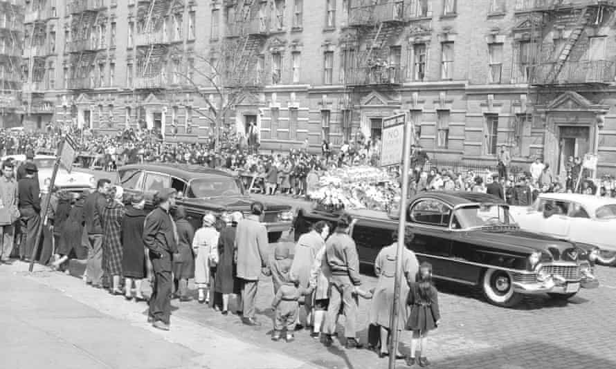 Onlookers line the streets in New York to watch the funeral procession of Paret, who died as a result of injuries sustained during the fight with Griffith.