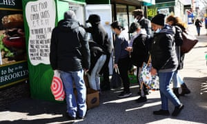 People pick up food from the a mutual aid group's refrigerator in the Fort Greene neighborhood of Brooklyn.