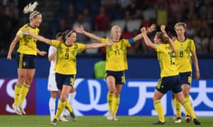 The Sweden players celebrate at the final whistle.