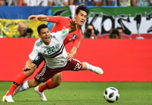 Lozano fights for the ball with Lee Yong tty Images