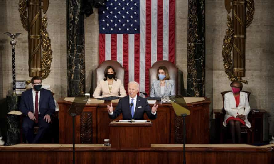 Biden speaks as Kamala Harris and Nancy Pelosi listen.