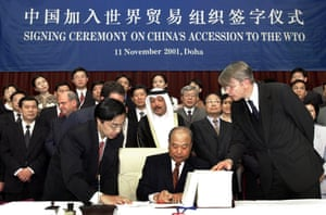 China's minister of foreign trade and economic co-operation on 11 November, 2001 signs documents for China's accession to the World Trade Organization, after 15 years of negotiations with trading partners, including the US.