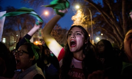 Pro-abortion activists demonstrate outside the Argentine embassy in Chile on Wednesday, hours before the Argentine senate rejected a bill to legalise the procedure