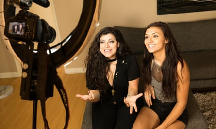 Bria Kam (left) and Chrissy Chambers recording a video for their YouTube channel at home in Los Angeles in August last year.