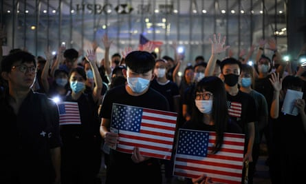 Protesters chant slogans as they attend a rally in Hong Kong calling on US politicians to pass the bill