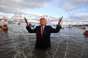 A person dressed as Donald Trump taking part in the Loony Dook swim in Scotland