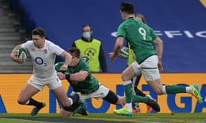 Ben Youngs of England beats CJ Stander of Ireland to go over to score their side's first try.