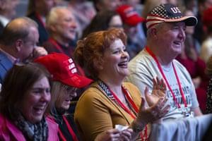 Supporters of Donald Trump applauds as he speaks.