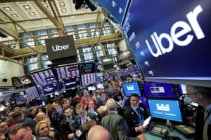 Traders gather at post where Uber Technologies Inc. holds IPO on floor of NYSE in New YorkTraders gather at post where Uber Technologies Inc. holds it's IPO on the floor of the New York Stock Exchange (NYSE) in New York, U.S., May 10, 2019. REUTERS/Brendan McDermid