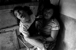 Reyna, 33, with her disabled daughter Cintia, 9, in a Honduras slum