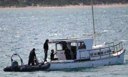 Police with the rescued fisherman at Victor Harbor, South Australia, on 10 September. The same boat is now missing again.