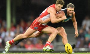 Luke Parker competes for the ball with Brad Ebert during the match between the Sydney Swans and Port Adelaide at the SCG on Saturday.