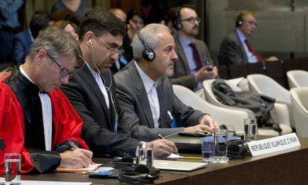 Iran's agent at the International Court of Justice, Mohammed Zahedin Labbaf, third left, listens to the ruling of the court on Wednesday.