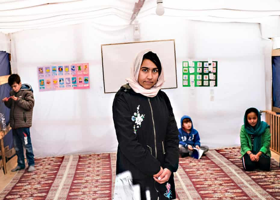 Azita Barekzai, a 19-year-old Afghan English teacher, poses inside a classroom at the school founded by Zekria Farzad