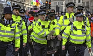 Police arrest protesters as they block traffic in Oxford Circus.