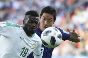 Senegal's Mbaye Niang, chased by Japan's Gen Shoji during the 2-2 draw at the Yekaterinburg Arena.
