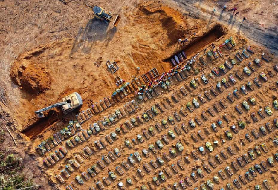 Aerial view of coffins being buried at an area where new graves have been dug at the Parque Tarumã cemetery in Manaus.