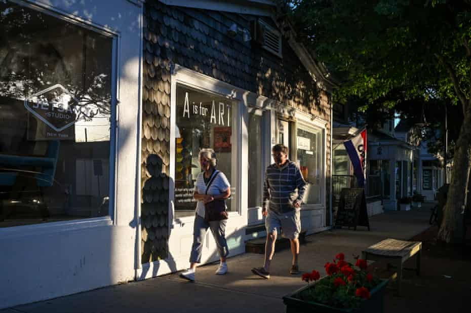 Pedestrians walk past businesses in downtown Southampton on Thursday, June 10, 2021 in Southampton, New York.