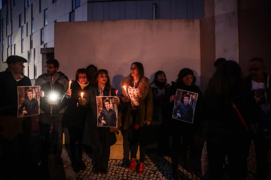 People attend a support vigil for Rui Pinto, in front of Judiciary Police prison facilities in Lisbon, Portugal in January 2020.