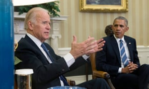 Barack Obama listens to Joe Biden discuss the release of the Cancer Moonshot Report, in the Oval Office.