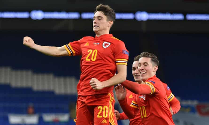 Daniel James (left) celebrates with fellow scorer Harry Wilson after putting Wales 2-0 up in Cardiff.