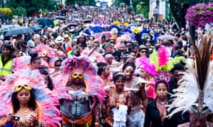 Revellers take part in the parade at Notting Hill carnival.