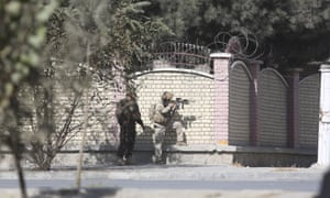 Afghan security personnel take a position near the Shamshad TV compound.