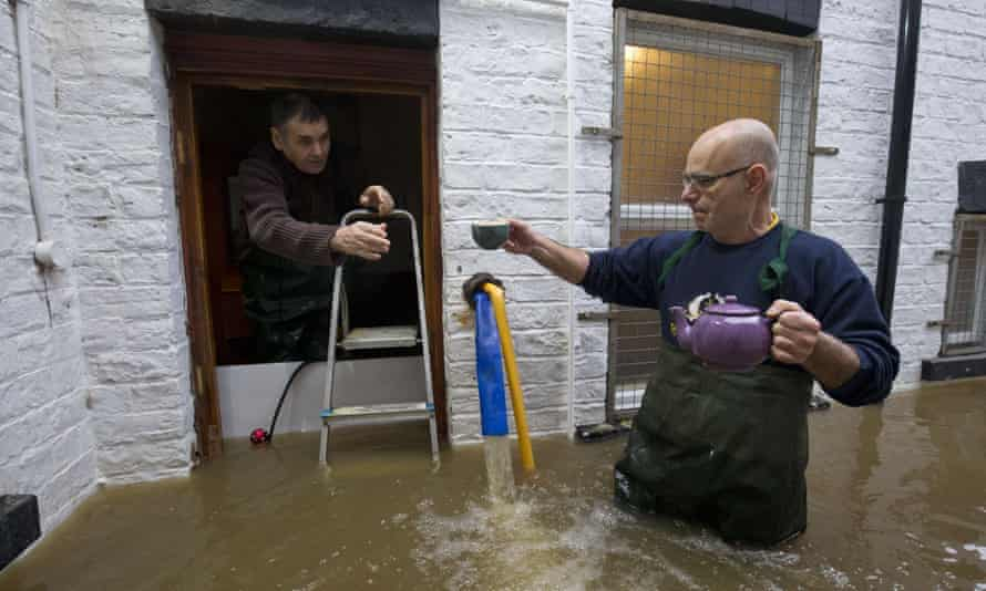Taxi firm workers at their flooded premises in York