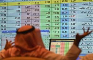 A Saudi broker monitors the stock market at the Arab National Bank in the Saudi capital Riyadh